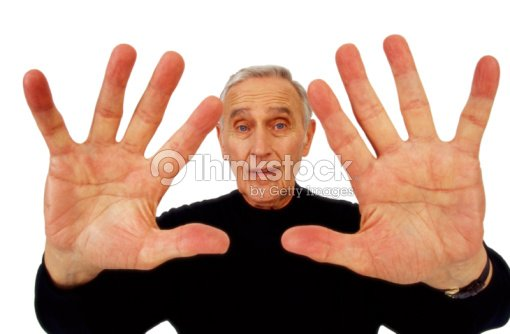 Mature man with hands out : Photo