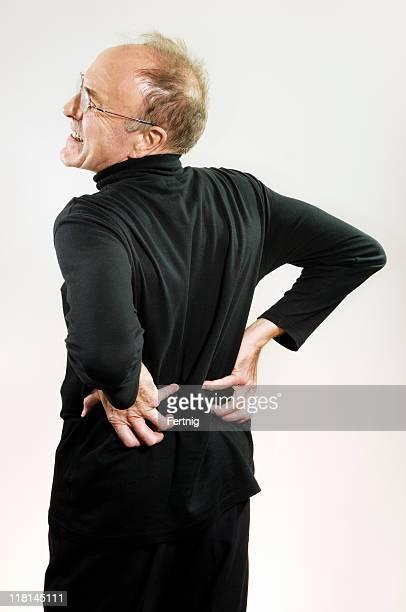 homem maduro com dor lombar - lower back - fotografias e filmes do acervo