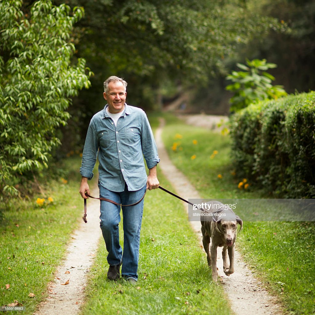Mature Man With Pet Dog At Park. : Stock Photo
