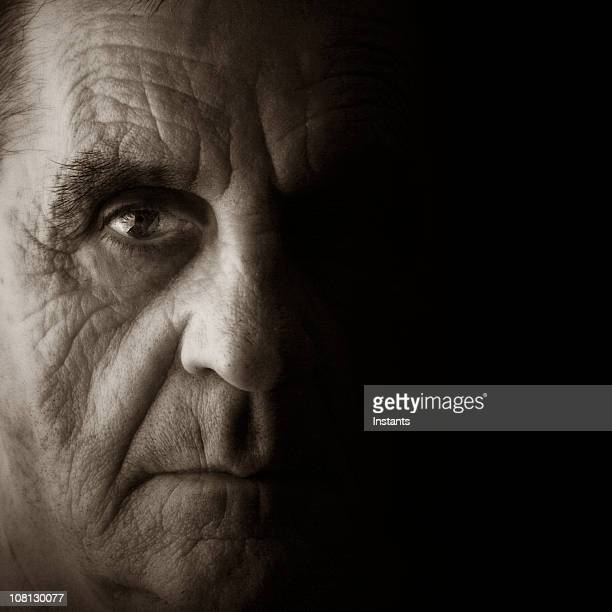 mature man with serious facial expression - organised crime stock pictures, royalty-free photos & images