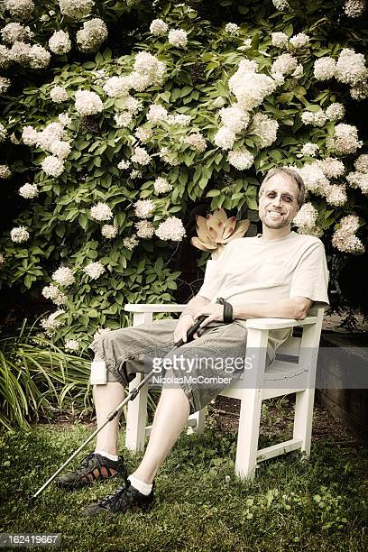 mature man with ms taking a break - multiple sclerosis stock photos and pictures