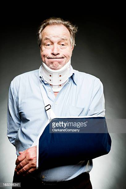 Mature Man With Whiplash With Neck Brace and Sling
