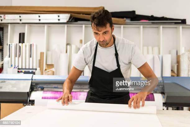 Mature man working at his printing-graphic design shop