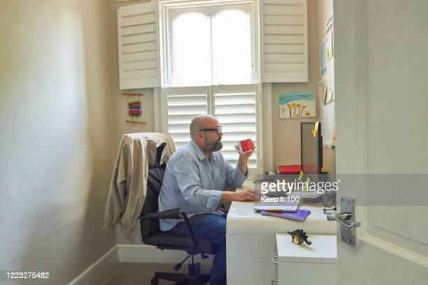 mature man working from home. - real people stock pictures, royalty-free photos & images