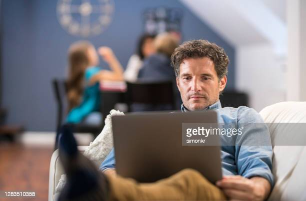 mature man working from home - incidental people stock pictures, royalty-free photos & images