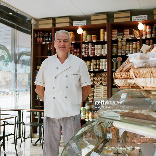Mature man working in delicatessen, portrait
