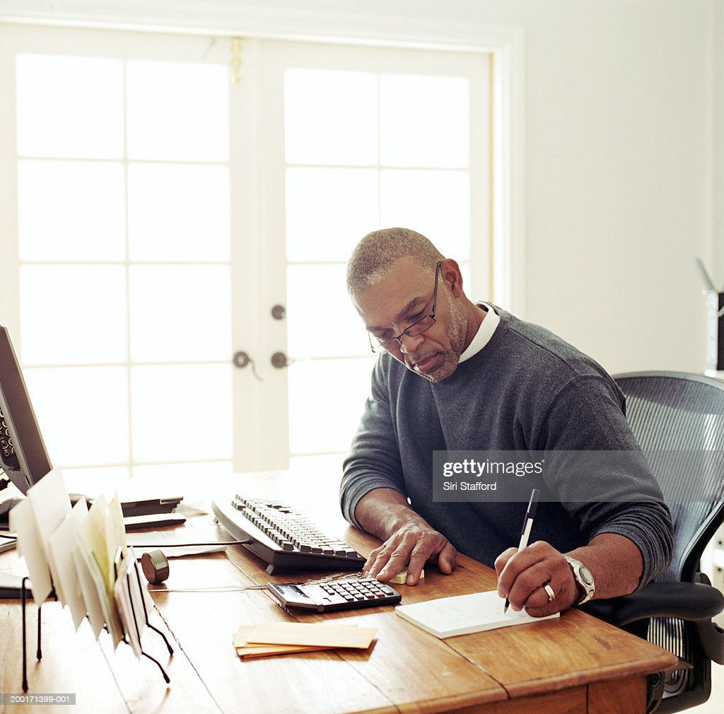 Mature man working in  home office : Stock Photo