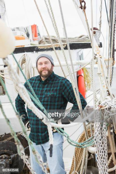 Mature man working on commercial fishing boat