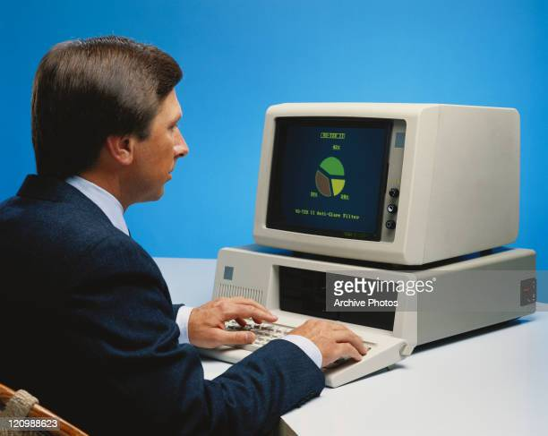 Mature man working on old computer