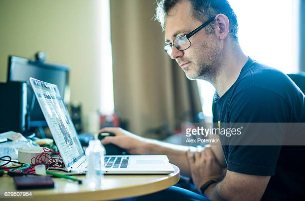 Mature man working with personal computer