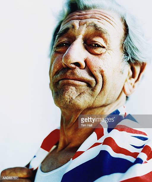 Mature man wrapped in British flag, portrait