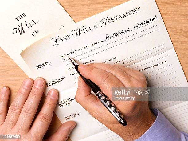 Mature man writing his will