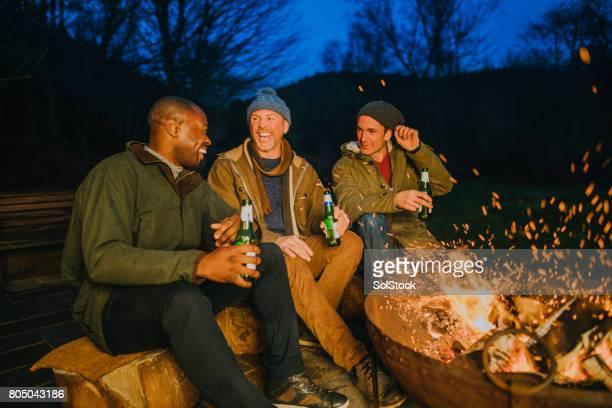 Mature Men Enjoying an Evening by the Fire
