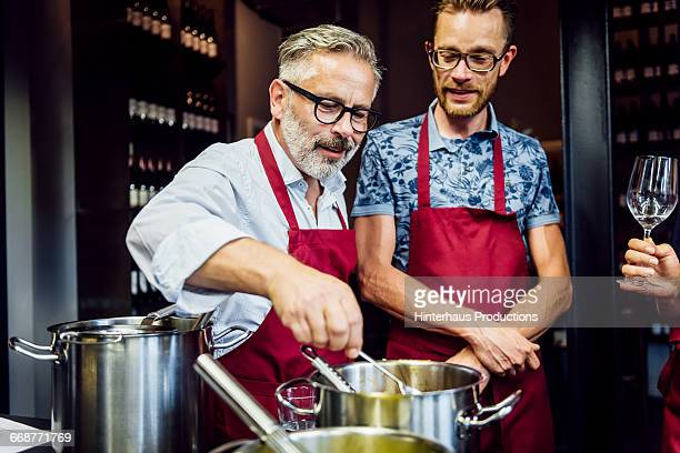 Mature men in a cooking class having fun