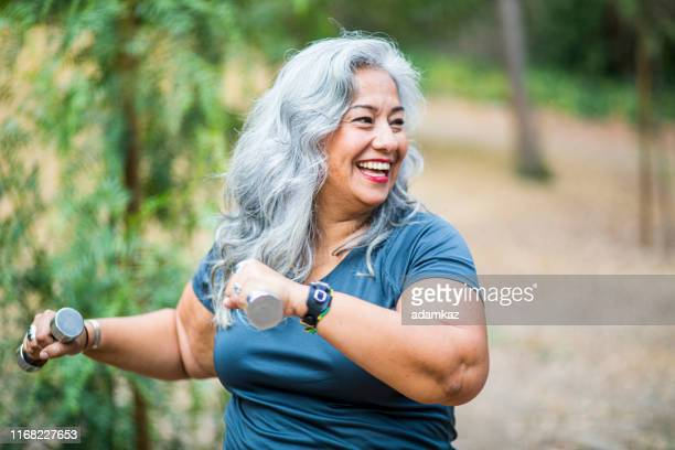 mature mexican woman working out - weight stock pictures, royalty-free photos & images