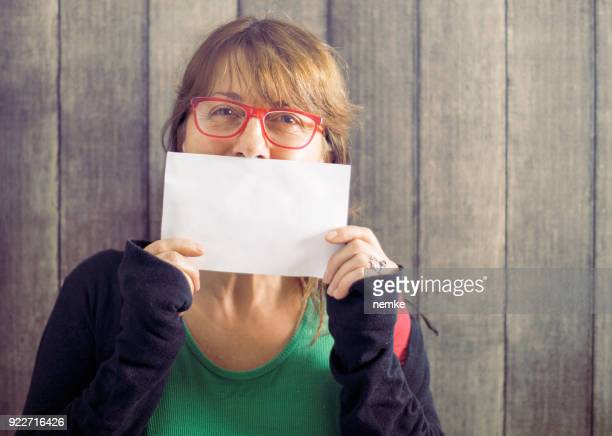 mature mid age woman holding blank board - holding stock pictures, royalty-free photos & images