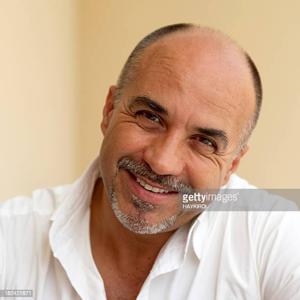 mature middle age bald man smiling - goatee stock pictures, royalty-free photos & images