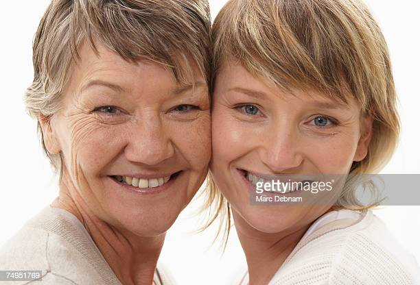Mature mother and daughter smiling, portrait, close-up
