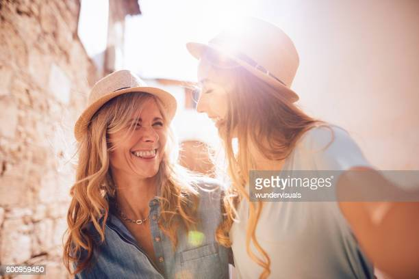 mature mother and young daughter taking selfies in italian town - spain italy stock pictures, royalty-free photos & images