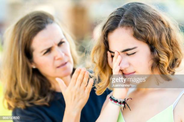 mature mother scolding her young daughter - slapping stock pictures, royalty-free photos & images