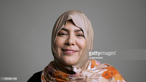 mature muslim woman looking at the camera - middle eastern culture stock pictures, royalty-free photos & images