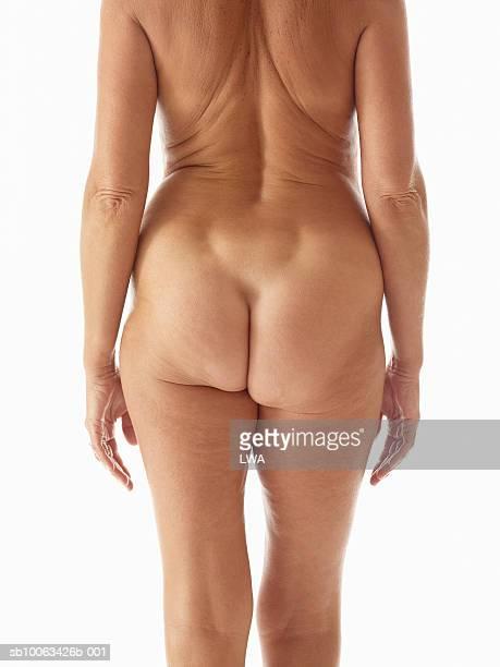 mature naked woman rear view, mid section - medelålders kvinnor naken bildbanksfoton och bilder