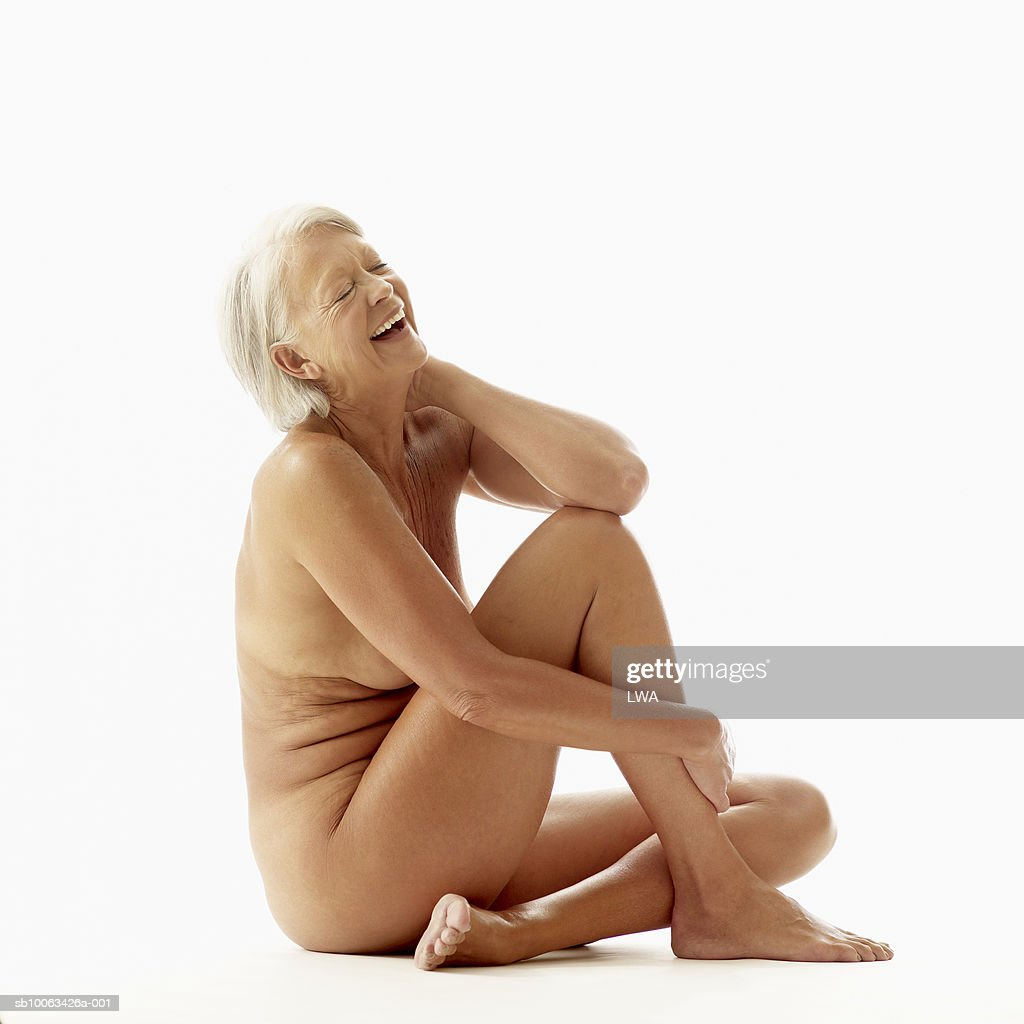 Mature Naked Woman Sitting On Floor Laughing High-Res -1170