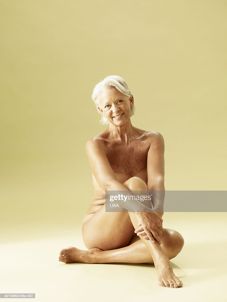 Mature Naked Woman Sitting On Floor Smiling Portrait Photo -1957