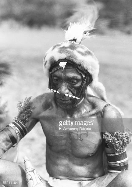 Mature native warrior with bone through nose Port Moresby