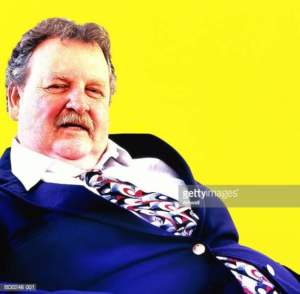mature, overweight male executive, portrait (digital enhancement) - unterschicht stereotypen stock-fotos und bilder