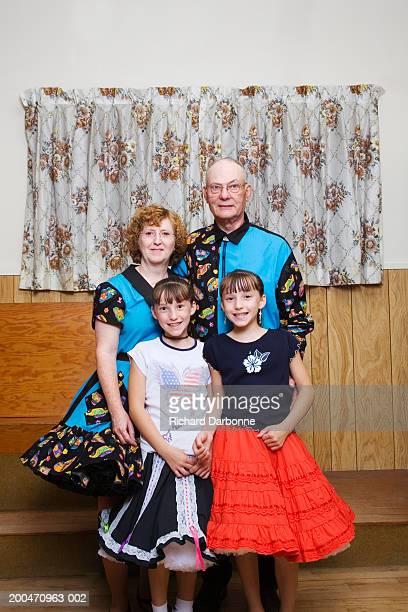 mature parents and twin daughters (8-10) in square dancing attire - tee reel bildbanksfoton och bilder