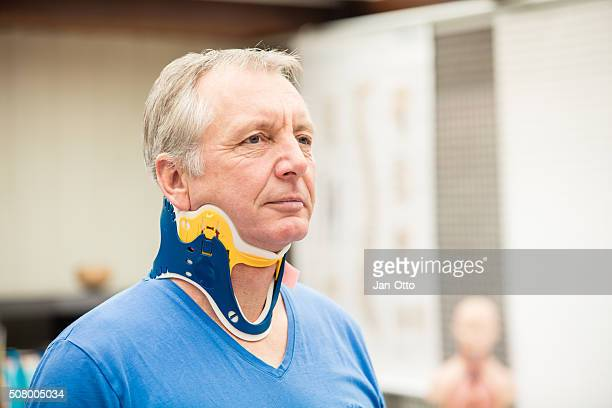 mature patient wearing a spine collar - brace stock pictures, royalty-free photos & images