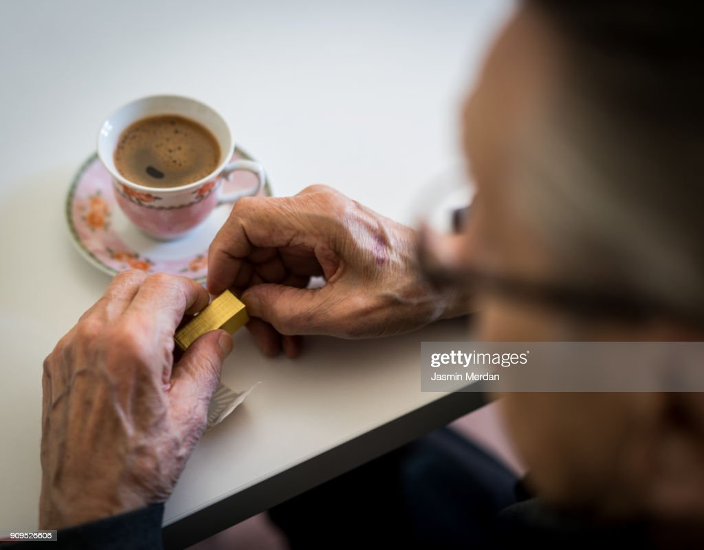 Mature person drinking coffee closeup : Stock Photo