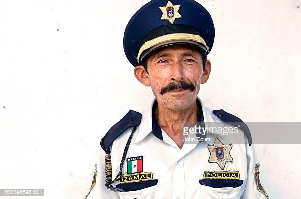 mature policeman smiling, portrait, close-up - uniform cap stock pictures, royalty-free photos & images