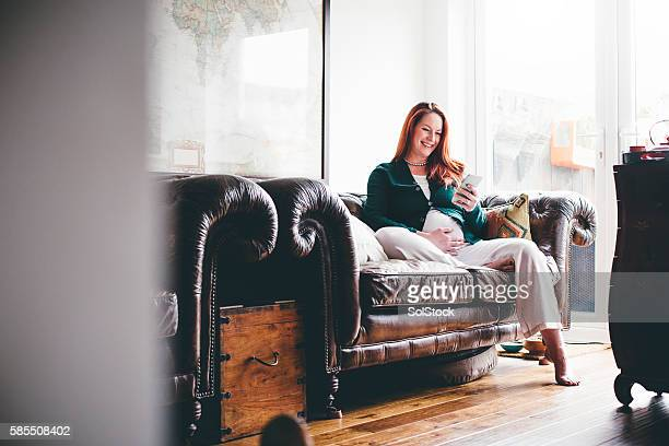 Mature Pregnant Woman Using Smartphone