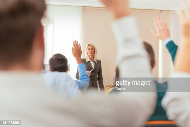 Mature professor and students in lecture hall