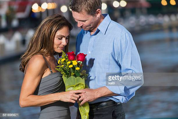 mature, romantic couple with bouquet of flowers - kali rose stock pictures, royalty-free photos & images