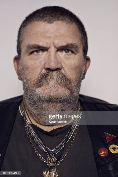mature rough looking man photographed on studio with hard lighting - motorcycle biker stock pictures, royalty-free photos & images