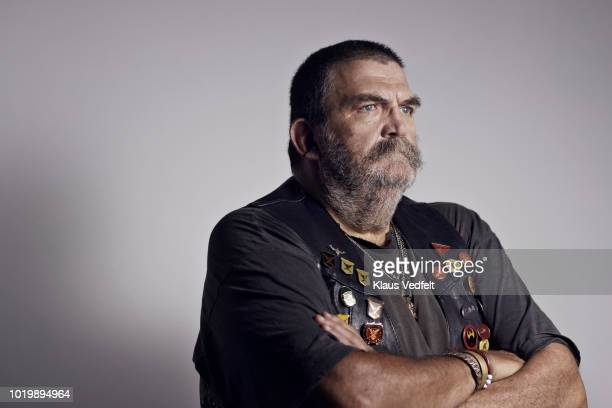 mature rough looking man photographed on studio with hard lighting - ecchi biker stock pictures, royalty-free photos & images