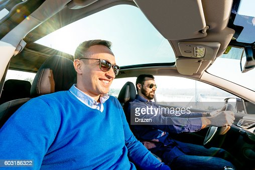 Mature Same Sex Couple Driving In Luury Car Stock Photo  Getty Images-8150