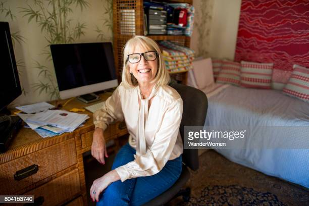 Mature senior woman working from home