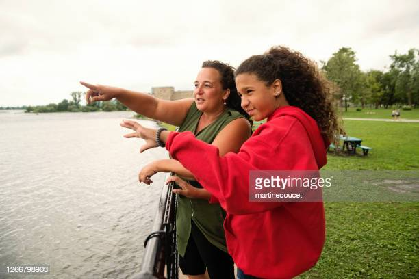 """mature single mother and teenage daughter family portrait on riverside. - """"martine doucet"""" or martinedoucet stock pictures, royalty-free photos & images"""