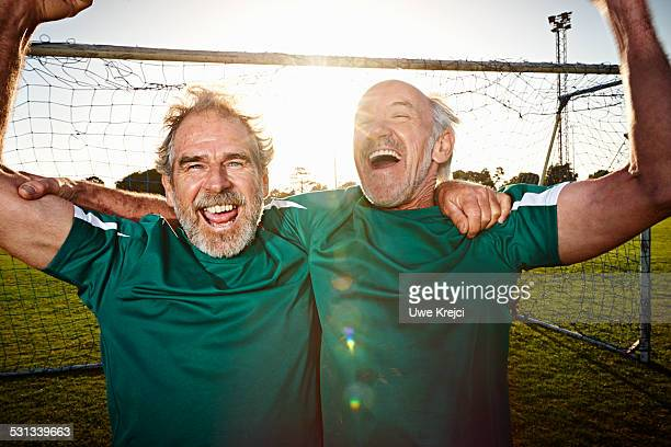 Mature soccer players cheering