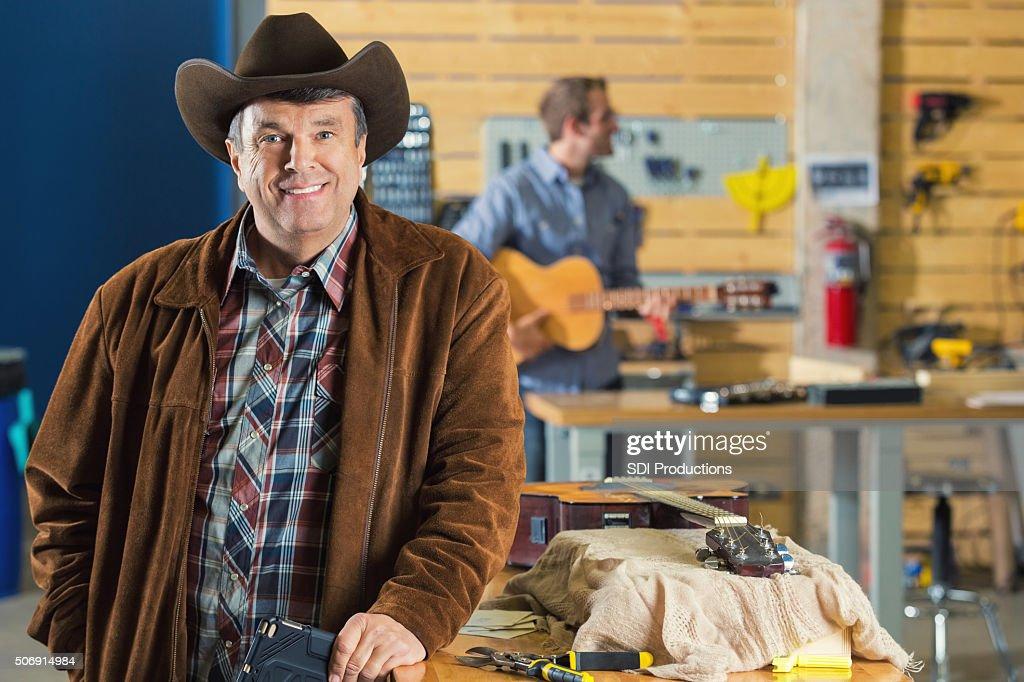 Mature Southern Businessman In Music Repair Workshop Stock
