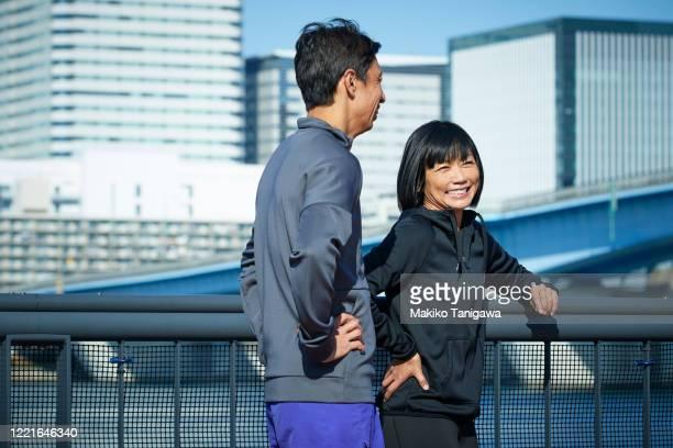 mature sportsman and sportswoman outdoors - スポーツ  ストックフォトと画像