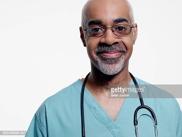 mature surgeon smiling, portrait, close-up - part of a series stock pictures, royalty-free photos & images