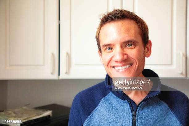 mature trans man portrait smiling in kitchen - autism stock pictures, royalty-free photos & images