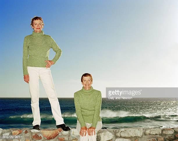 Mature twins by sea, portrait (Digital Composite)