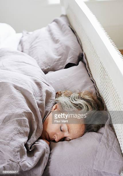 mature woman 46-50 asleep in bed