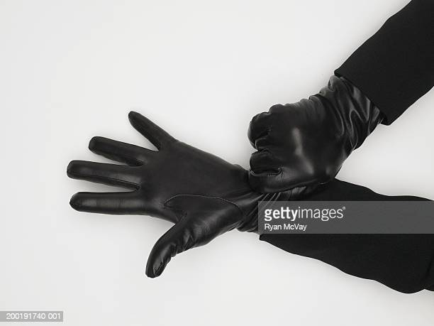 mature woman adjusting leather gloves, close-up of hands - leather glove stock pictures, royalty-free photos & images